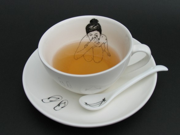 bathing_girl_teacup_filledwithtea